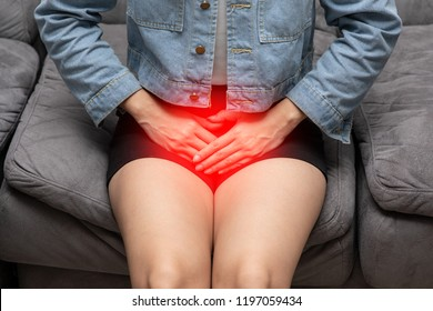 woman have bladder or uti pain sitting on bed in bedroom after wake up feeling so illness,Healthcare concept