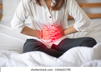 woman have bladder or uti pain with vaginal problem sitting on bed in bedroom after wake up feeling so illness,Woman Healthcare concept