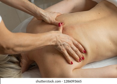 A woman have a massage at beauty spa.