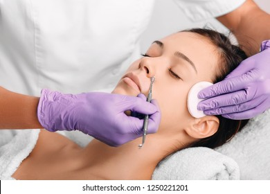 woman have mechanical facial cleansing, procedure for cleansing pores and skin from defects