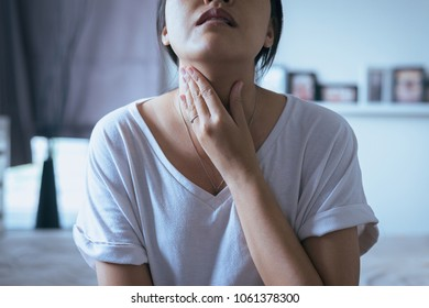 Woman have a sore throat,Female hands holding neck,Choke symptoms,Neck bone sticking out