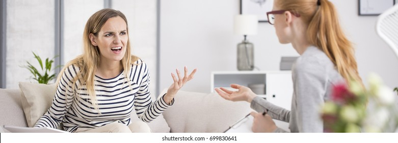 Woman having anger attack at psychotherapist's office