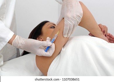 Woman Having Arm Fillers Treatment at Beauty Clinic