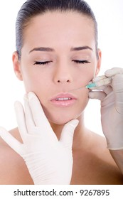 woman having beauty treatment, silicone injection in lips