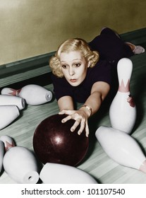 Woman having bowling accident