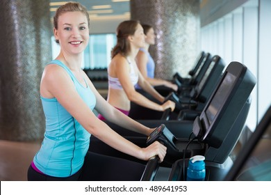 Woman Having Cardio Workout on Treadmill in Gym