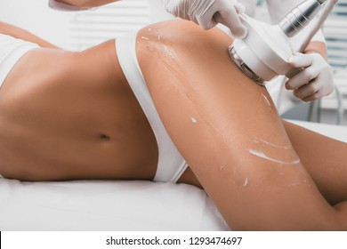 woman having cavitation, procedure removing cellulite on her buttocks , lifting buttocks
