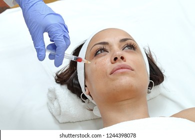 Woman Having Cheek Injection Treatment at Beauty Clinic