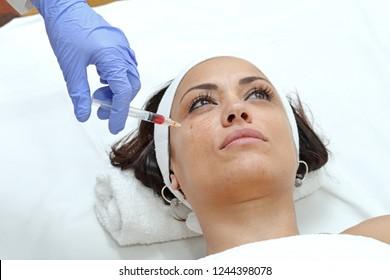 Woman Having Cheek Injection Treatment at Beauty Clinic