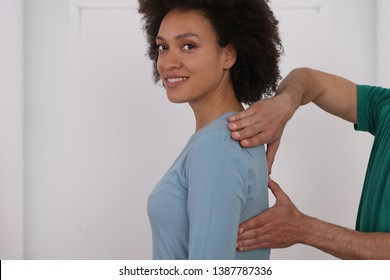 Woman having chiropractic back adjustment. Osteopathy, Physiotherapy, Injury rehabilitation concept