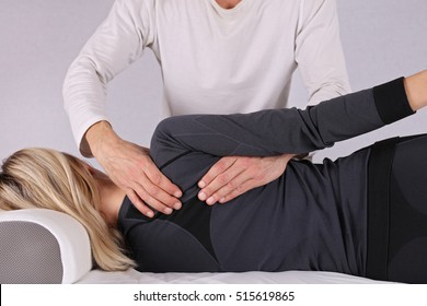 Woman having chiropractic back adjustment close up. Osteopathy, Alternative medicine, pain relief concept