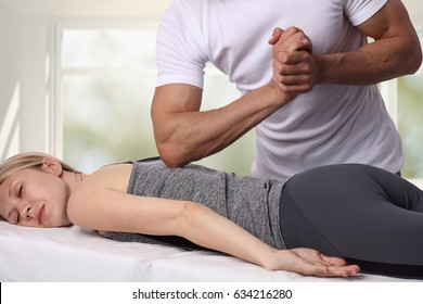 Woman having chiropractic back adjustment. Osteopathy, Acupressure, Alternative medicine, pain relief concept. Physiotherapy, sport injury rehabilitation