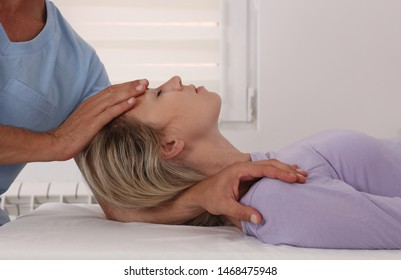 Woman having chiropractic back and neck adjustment. Osteopathy, Physiotherapy, sport injury rehabilitation