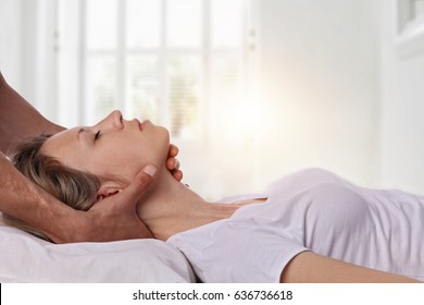 Woman having chiropractic back and neck adjustment. Osteopathy, Acupressure, Alternative medicine, pain relief concept. Physiotherapy, sport injury rehabilitation
