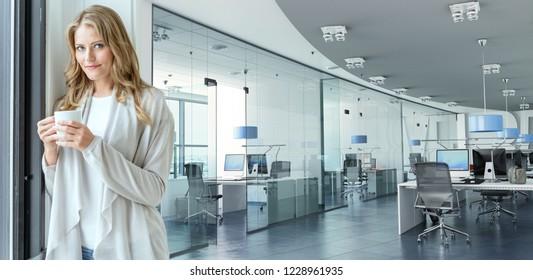 Woman having a coffee break in a corporate office