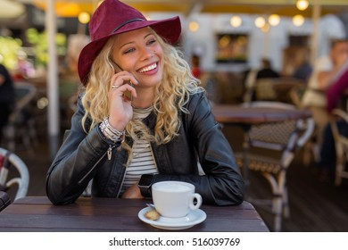 Woman having coffee and talking on the phone