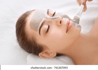 Woman having cosmetic mask in spa salon