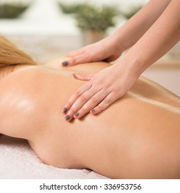 Woman having done massage in spa center