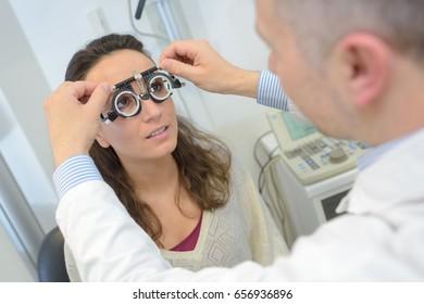 woman having eye test eye test machine