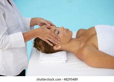 Woman having face massage