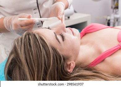 Woman having a facial massage and peeling in beauty salon