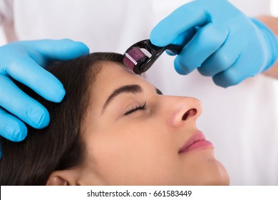 Woman Having Facial Treatment On Her Face In Beauty Salon
