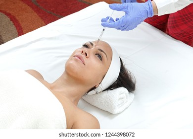 Woman Having Forehead Injection Filler Treatment at Beauty Clinic