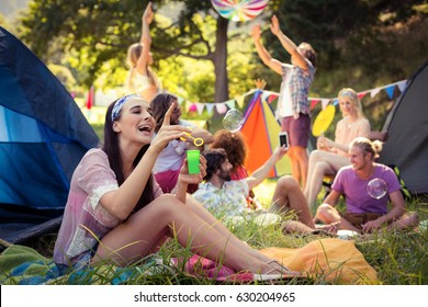 Woman having fun at campsite on a sunny day
