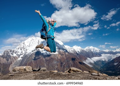 Woman is having fun while climbig to Manaslu base camp in highlands of Himalayas on Manaslu circuit
