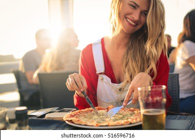 Woman having great time with friends, eating pizza