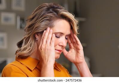 Woman having headache migraine. Stress and depression.