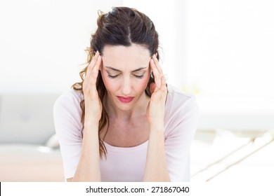 Woman having headache on white background