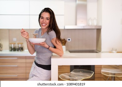 Woman Having Healthy Breakfast cereal