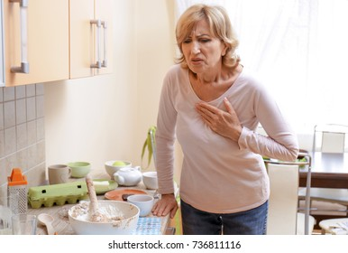 Woman having heart attack at home