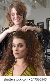A woman having her hair styled at the salon
