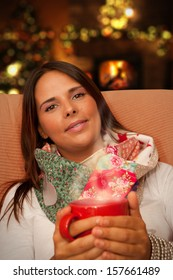 Woman having Hot Drink during Christmas night seating at her home waiting for presents