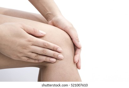 Woman having knee pain in medical office. osteoarthritis joint pain after sport. Breaks and sprains of the knee joint