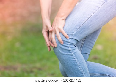 Woman having knee pain in park,after she exercise.woman with knee pain .