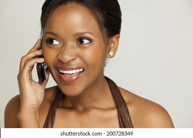 Woman having a light-hearted conversation on her mobile phone.