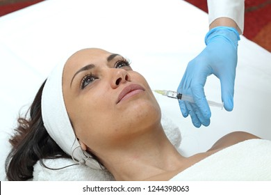 Woman Having Lips Augmentation Filler Injection at Beauty Clinic