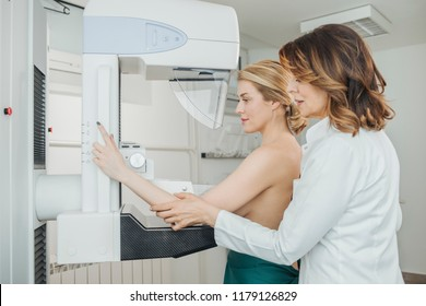 A woman having mammography examination at hospital.