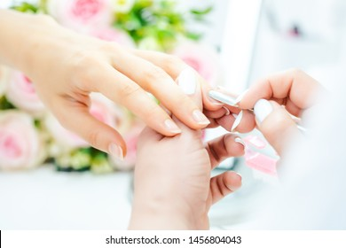 Woman having a manicure in beauty parlor