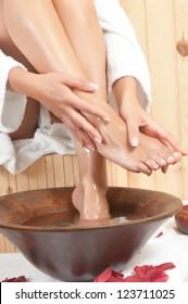 woman having a massage in beautiful legs