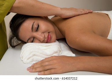 Woman having massage of body in the spa salon,Woman enjoying a wellness back massage in a spa, Masseur doing massage on the back of woman in the spa salon. Beauty treatment concept