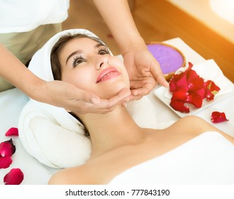 Woman having massage of face in the spa salon, Pampering and massage for beautiful face of young woman in spa salon – indoors, Masseur doing massage on woman face. Beauty treatment concept,