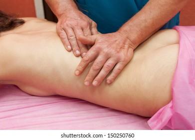 Woman having a massage at spa
