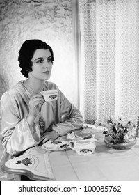 Woman having meal at table