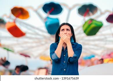 Woman Having Motion Sickness on Spinning Ferris Wheel Background Vertigo suffering patient having a panic attack after carousel ride