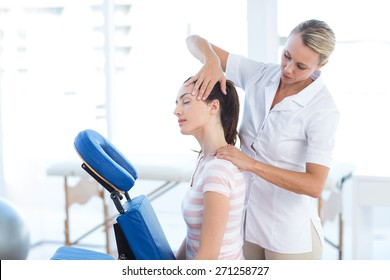 Woman having neck massage in medical office