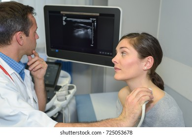 woman having neck ultrasound